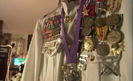 A screenshot of the show Hoarders by A&E of the episode with Sir Patrick displaying fake military uniform and medals.
