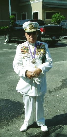 A picture of Roger Eldon Floyd Sisson otherwise known as Sir Patrick wearing a fake military uniform and fake medals.