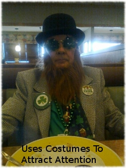 Picture of Patrick O'Shannahan aka Khristian Knight aka Roger Sisson wearing a Leprechaun outfit and beard in a restaurant.